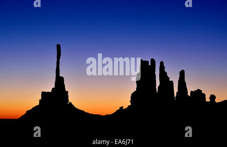 Silhouette of Totem Pole and Yei Bi Chei, Monument Valley, Arizona Utah border, USA - Stock Photo