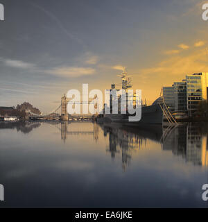 UK, London, HMS Belfast and Tower Bridge seen from water line - Stock Photo