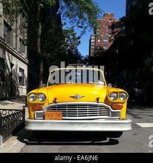 Yellow cab parked on the street, Manhattan, New York, America, USA - Stock Photo