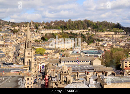 Cityscape of the City of Bath with St Michael's Church spire and Georgian architecture of Camden Crescent in background - Stock Photo