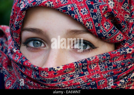 Fair skinned Sikh girl wearing Burqa; England - Stock Photo