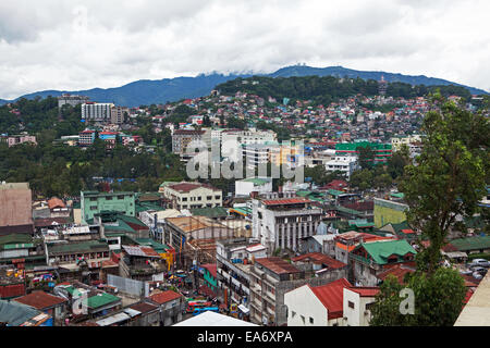 Overpopulated living conditions in Baguio City, Philippine Islands. Commercial building and homes compete for space. - Stock Photo