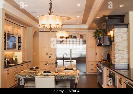 Kitchen in luxurious custom built estate home; Edmonton, Alberta, Canada - Stock Photo