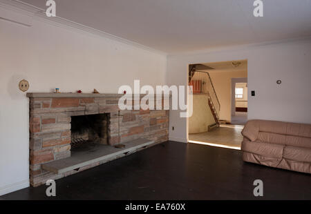 A fireplace in a den of an abandoned house.  Near Oakville, Ontario, Canada.  This House has since been demolished. - Stock Photo