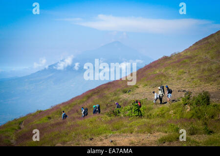 Local climbers on Mount Guntur, West Java. In the background is Mount Cikuray. - Stock Photo
