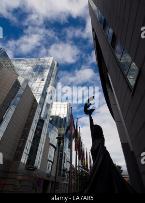 'Europe' statue of a woman holding the Euro symbol next to the European Union Parliament building in Brussels, Belgium, - Stock Photo