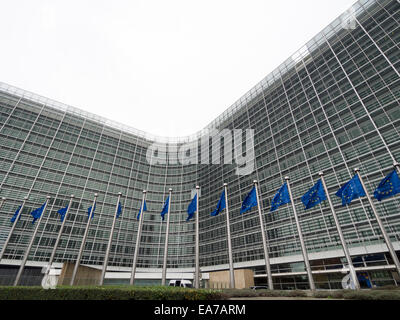 European Union flags in front of the Berlaymont building, headquarters of the European commission in Brussels, Belgium, - Stock Photo