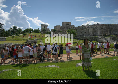 Tourists visiting the Mayan ruins at Tulum, Mexico - Stock Photo