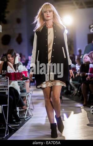 Calgary, Alberta, Canada. 7th Nov, 2014. A model struts down the catwalk while showing off a Dolce & Gabbana dress - Stock Photo
