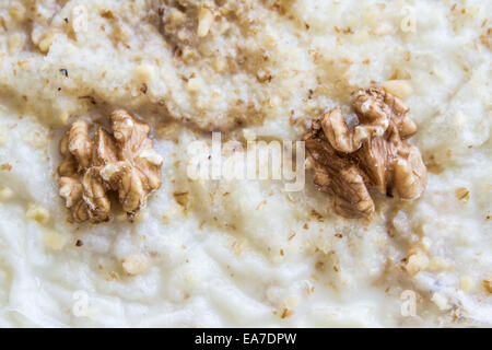 Gullac, Turkish traditional milk dessert with walnut on wooden background - Stock Photo