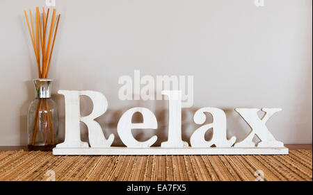 Relax written in large wooden letters with copy space - Stock Photo