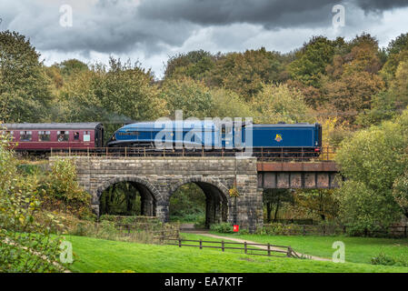 The A4 Pacific Sir Nigel Gresley crosses the Burrs Park viaduct. The East Lancashire Railway Autumn steam gala Oct - Stock Photo