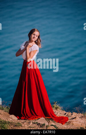 Beautiful girl dressed in white and red dress - Stock Photo