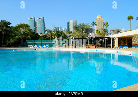 Luxury hotel swimming pool in the middle of the commercial center of Doha, the capital of the Arabian Gulf country - Stock Photo