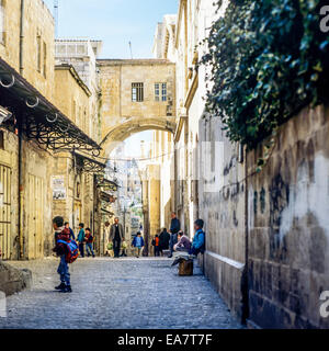 Span of the Ecce Homo arch outside the church over Via Dolorosa Jerusalem Israel - Stock Photo