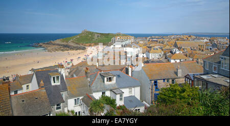 Panoramic view across houses to Porthmeor Beach and St Ives Head on a Sunny summers afternoon St Ives Penwith West - Stock Photo
