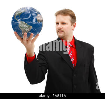 Powerful business man looking at Earth globe held in his hand - Stock Photo