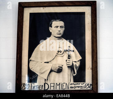 A framed 19th-century photographic portrait of Belgian missionary priest Joseph De Veuster, best known to the world - Stock Photo