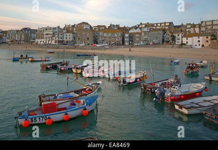 Boats in St Ives Harbour in evening light Penwith West Cornwall South West England UK - Stock Photo