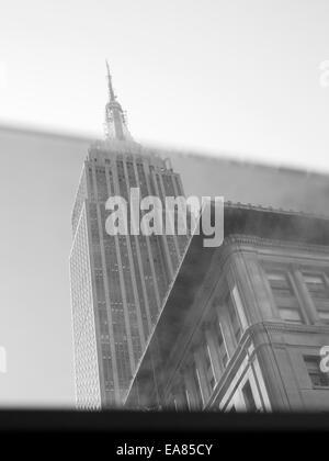 Empire State Building seen through car window - Stock Photo