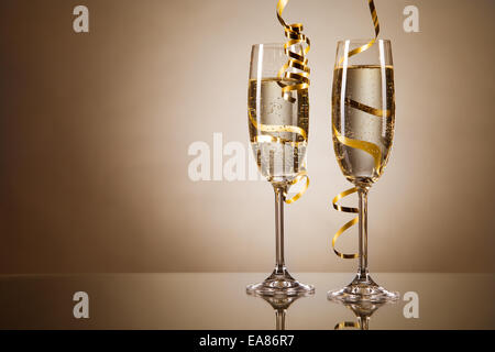 Glasses of champagne with ribbons - Stock Photo