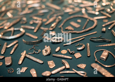LONDON, UK - Known as the The Cuerdale Hoard, this collection of Viking silver is on display in the British Museum - Stock Photo