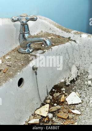 dirty sink covered with builders debris - Stock Photo