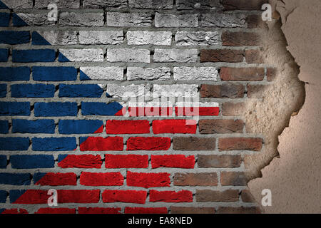 Dark brick wall texture with plaster - flag painted on wall - Czech Republic - Stock Photo