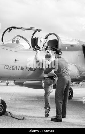 A young boy gets shown a Czech air force Aero L-159 Alca multi-role aircraft at the Malta International Airshow - Stock Photo