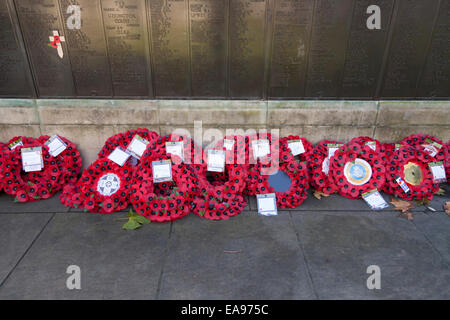 Remembrance Sunday poppy wreaths at the Tower Hill Memorial in Trinity Square Gardens, opposite the Tower of London - Stock Photo