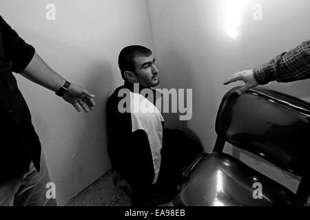 A captured Iraqi ISIS militant by the name of Sina Obeid sitting tied up at the interrogation room of the intelligence - Stock Photo