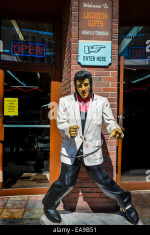 A resin statue of Elvis Presley greets customers in front of the Legends Gift shop on lower Broadway in downtown - Stock Photo