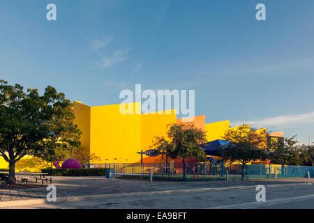 Brightly coloured colored Miami's Children's Museum fenced playground with shade awning in Miami Florida, USA. - Stock Photo