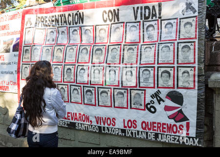 People view a banner demanding justice for the missing students believed executed by corrupt police hang from the - Stock Photo