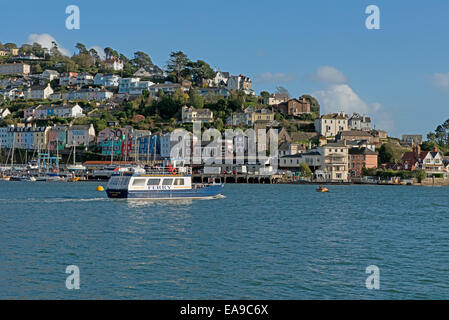 Dartmouth/Kingwear Ferry cruising along the River Dart  with a landscape view of  Kingswear in the background, South - Stock Photo