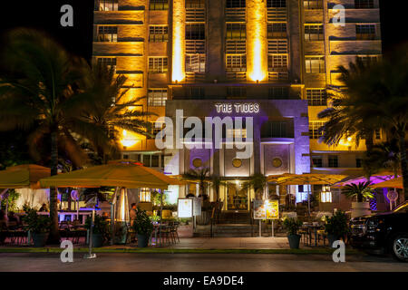 The neon illuminated Art Deco facade of the Tides hotel and terrace dining on Deco Drive in Miami's South Beach, - Stock Photo