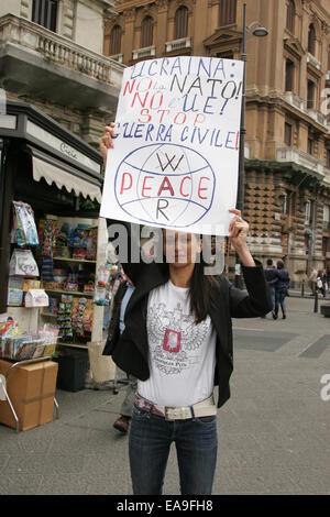 Protester from Naples brings banner and shout slogans against Ukraine's military occupations, as they witnessed - Stock Photo