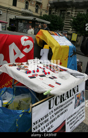 Banners posted by the protesters against Ukraine's military occupations, as they witnessed the massacre of thousands - Stock Photo