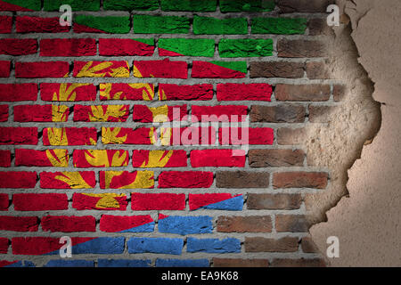 Dark brick wall texture with plaster - flag painted on wall - Eritrea - Stock Photo