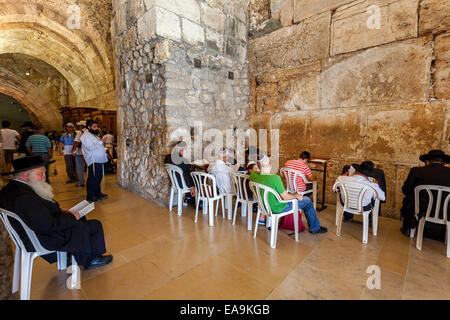 People praying in Cave synagogue in Jerusalem, Israel. - Stock Photo