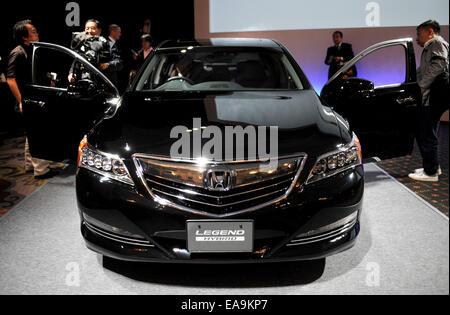 Tokyo, Japan. 10th Nov, 2014. Journalists look at Honda's renewed model 'LEGEND' during a press conference in Tokyo, - Stock Photo