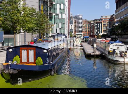 Narrowboats in Paddington Basin on the short Paddington Arm of the Grand Union Canal - Stock Photo