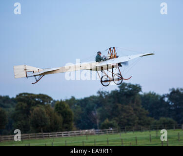 The original 1910 Deperdussin monoplane aircraft flying at Old Warden Airfield in October 2014 - Stock Photo