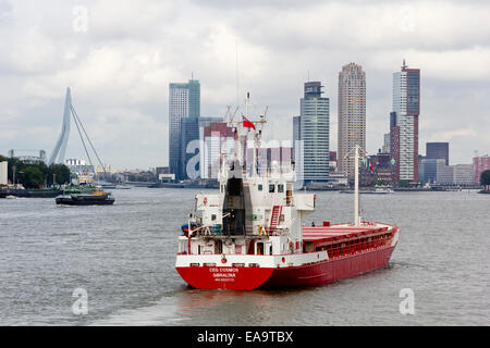Landmarks of the Kop van Zuid district of Rotterdam, Netherlands - a ship entering the city on the Nieuwe Maas. - Stock Photo