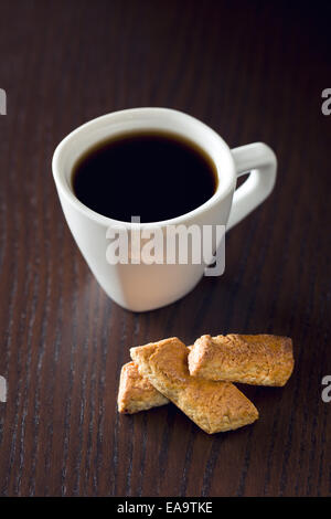 almond cookies and coffee on wooden table - Stock Photo