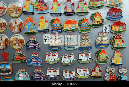 Souvenir fridge magnets and badges on display in old town of Bratislava. - Stock Photo