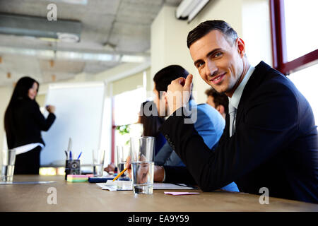 Businesspeople sitting on the meeting at office - Stock Photo