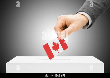 Voting concept - Male inserting flag into ballot box - Canada - Stock Photo