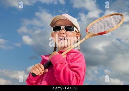 little girl with racket for badminton