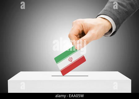 Voting concept - Male inserting flag into ballot box - Iran - Stock Photo